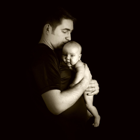 0 3 months: Newborn baby on the fathers hands