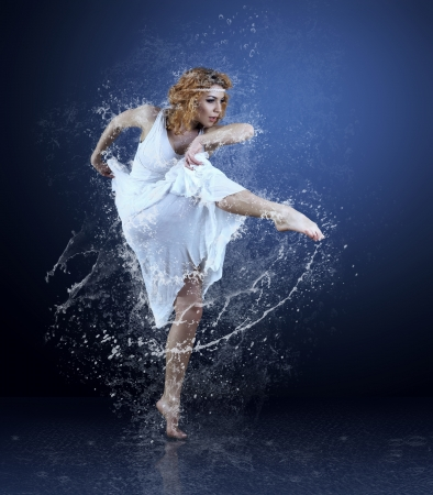 Dance of ballerine around water splashes and drops photo