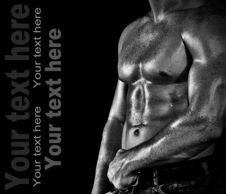 Bodybuilder posing on the black background Stock Photo - 16567897