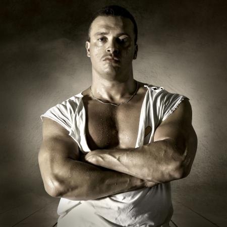 Bodybuilder posing on the outdoor grunge background Stock Photo - 16569432