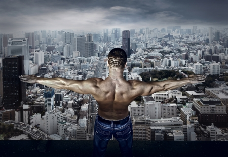 Man stay on the roof of skyscraper Stock Photo - 16570846