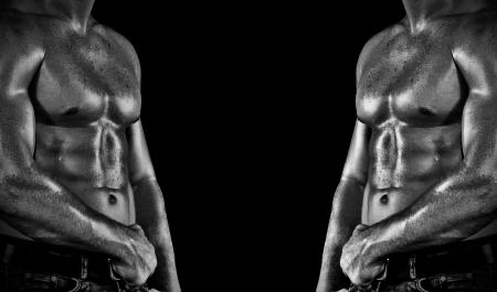muscular men: Bodybuilder posing on the black background Stock Photo