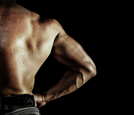 Bodybuilder posing on the black background Stock Photo - 16637695