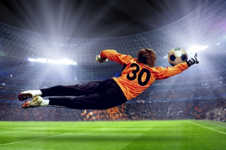 stadium: Football goalman on the stadium field Stock Photo