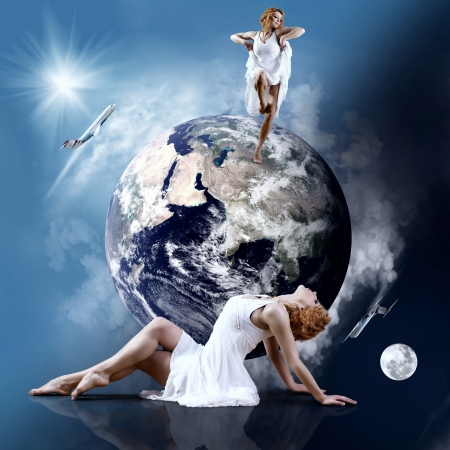 Ballerina stay in dancing pose on the Planet Earth. Stock Photo - 16970050