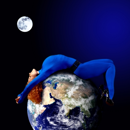 Woman in blue sleeping on the planet in space. Stock Photo - 17008757