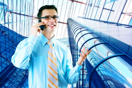 Hapiness Businessman standing on the business background photo