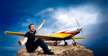 Man on the top of mountain and airplane photo