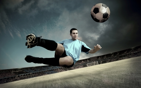 football player on soccer field of stadium with drammatic sky photo
