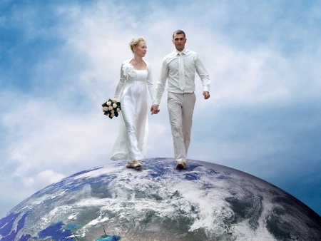 affectionate actions: Wedding couple go on the Planet Earth