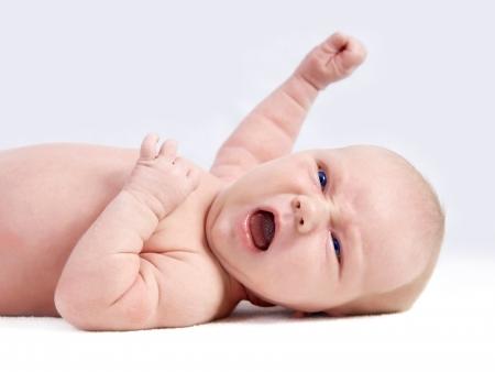 quiet baby: Newborn baby on the light background Stock Photo