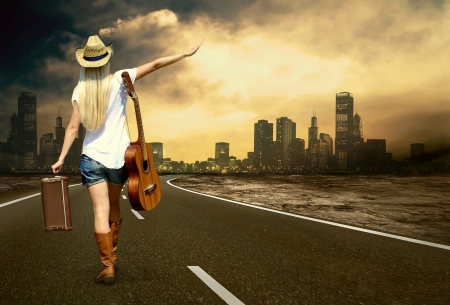 rock singer: Young woman with guitar on the road and her vintage baggage