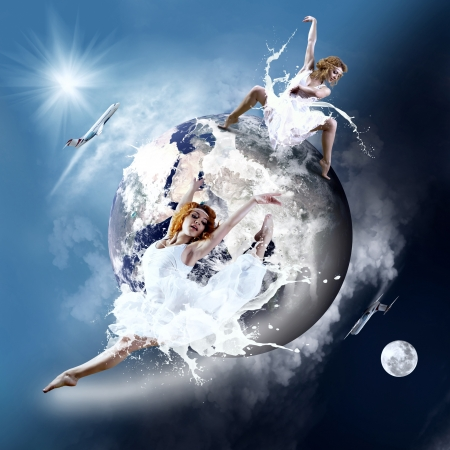 Ballerina stay in dancing pose on the Planet Earth. photo