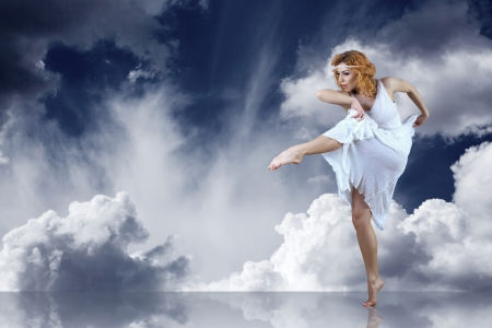 Dance element of ballerina in white under sky photo