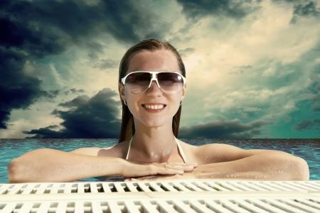 waterpool: Beautiful happiness girl in white bikini stay in the waterpool