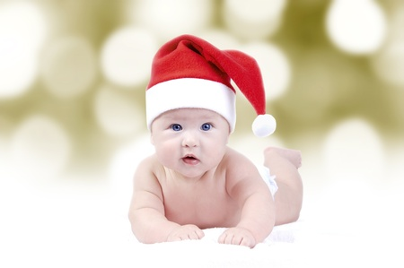 Baby in New Years hat on the bokeh background photo