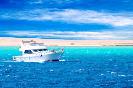 way out: Side view of motor yacht under way out at sea