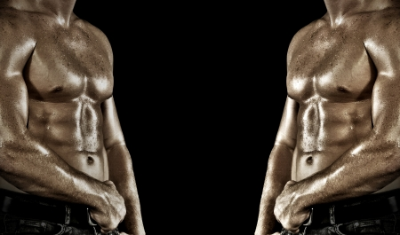 Bodybuilder posing on the black background photo
