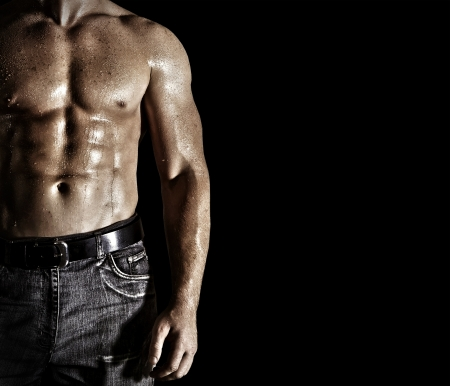 pectoral: Bodybuilder posing on the black background Stock Photo