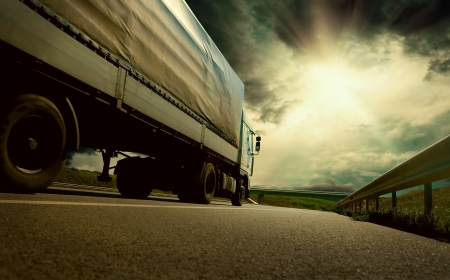 truck on highway: Beautiful view with truckcar on the road  under sky with clouds