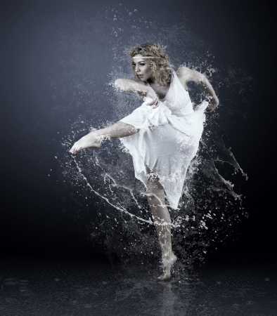 Dance of ballerine around water splashes and drops Stock Photo - 18574741