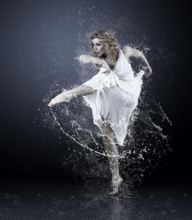 Dance of ballerine around water splashes and drops Stock Photo - 18574741
