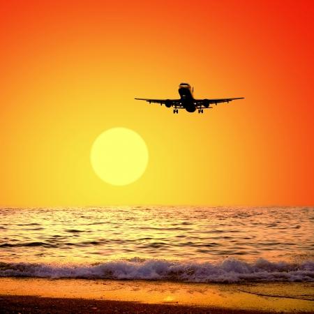 Beautiful sea nature landscape on the sunrise sky with airplane photo