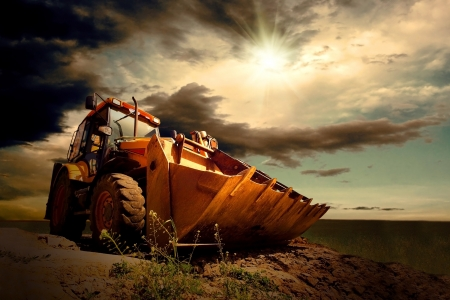 cloud industry: Yellow tractor on sky background