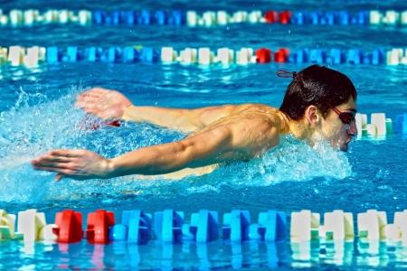head start: Swimmer in waterpool swim one of swimming style