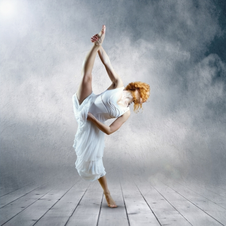 Dance element of ballerina in white dress photo