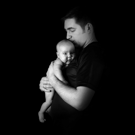 a serene life: Newborn baby on the fathers hands