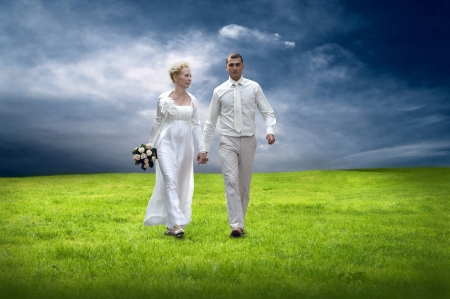 affectionate actions: Weddings couple in white go outdoor Stock Photo