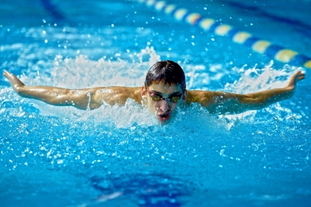 swim goggles: Swimmer in waterpool swim one of swimming style