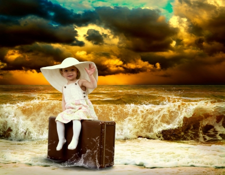 Young child with baggage on the tropical beach photo