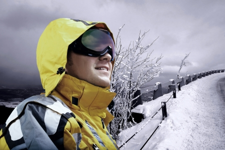 mounts: Portrait of man wearing a helmet and glasses on the background of snow winter and mounts