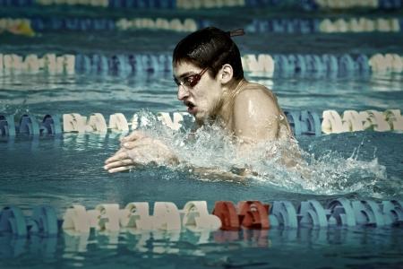 waterpool: Swimmer in waterpool swim one of swimming style