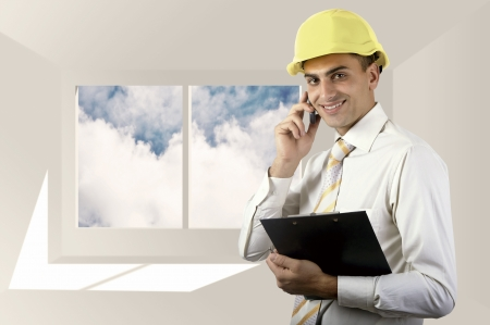 Young architect wearing a protective helmet standing on the building outdoor  Stock Photo - 22689034