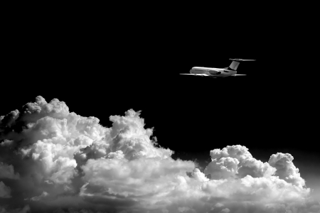 Airplane at fly on the sky with clouds Stock Photo - 23046007
