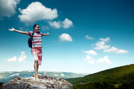 Man on the top of mountain photo