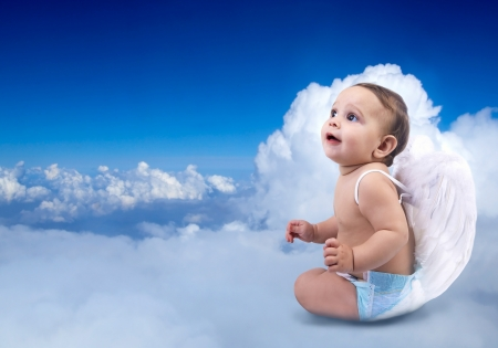 angel: Beautiful Baby angel sitting on the clouds
