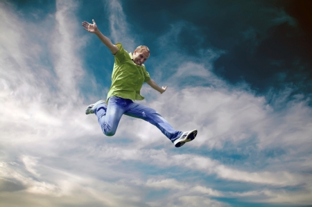 Jump of man under sky with clouds photo