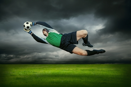 Football goalkeeper in action outdoors photo