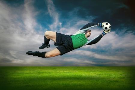open garden gate: Football goalkeeper in action outdoors Stock Photo