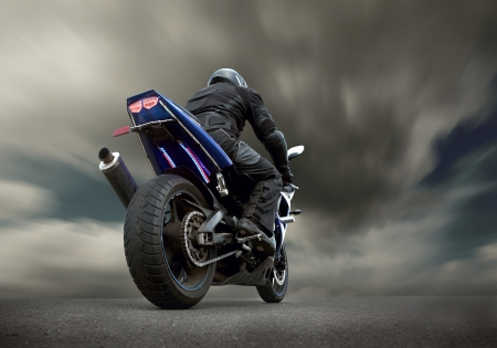 Man seat on the motorcycle under sky with clouds Stock Photo - 24259873
