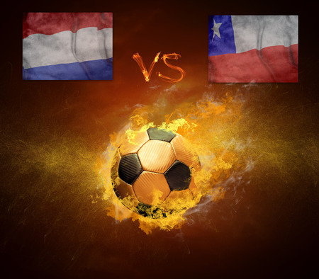 Hot soccer ball in fires flame, friendly game Holland and Chili photo