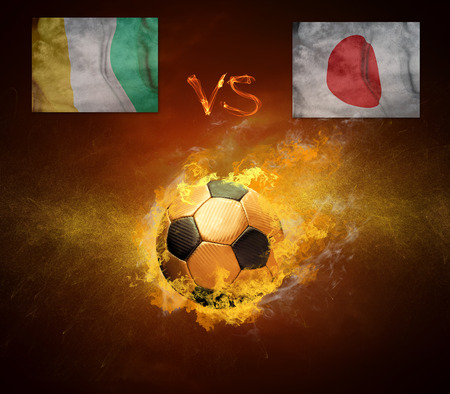 cote d'ivoire: Hot soccer ball in fires flame, friendly game Cote d Ivoire and Japan Stock Photo