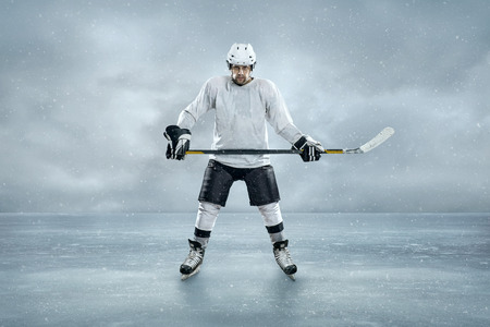 hockey player: Ice hockey player on the ice