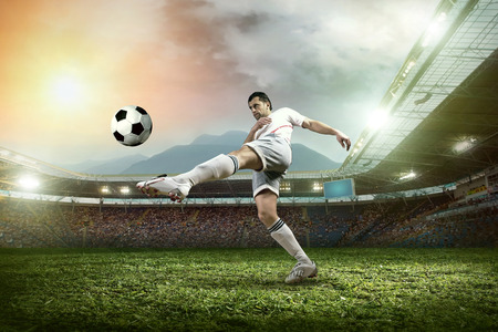 open garden gate: Soccer player with ball in action outdoors. Stock Photo