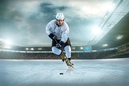 hockey player: Ice hockey player on the ice. Open stadium - Winter Classic game.