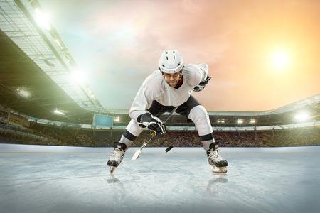 Ice hockey player on the ice. Open stadium - Winter Classic game. photo